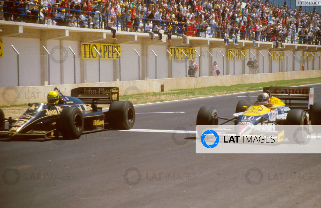 Jerez, Spain.11-13 April 1986.Ayrton Senna (Lotus 98T Renault) crosses the line 14/100ths of a second ahead of Nigel Mansell (Williams FW11 Honda) for the win. One of the closest finishes in grand prix history.Ref-86 ESP 10.World Copyright - LAT Photographic