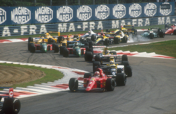 1990 Italian Grand Prix.Monza, Italy.7-9 September 1990.Nigel Mansell (Ferrari 641) followed by Riccardo Patrese, Thierry Boutsen (both Williams FW13B Renault's), Alessandro Nannini and Nelson Piquet (both Benetton B190 Ford's) through the Rettifilo Chicane at the start. Behind Pierluigi Martini (Minardi M190 Ford) locks up.Ref-90 ITA 10.World Copyright - LAT Photographic