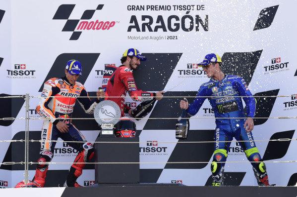 Francesco Bagnaia, Ducati Team, Marc Marquez, Repsol Honda Team, Joan Mir, Team Suzuki MotoGP podium.