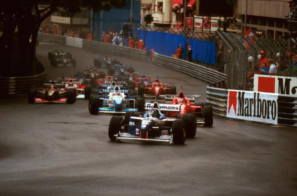 Monte Carlo, Monaco.16-19 May 1996.Damon Hill (Williams FW18 Renault) leads Michael Schumacher (Ferrari F310) into Ste. Devote at the start.Ref-96 MON 07.World Copyright - LAT Photographic
