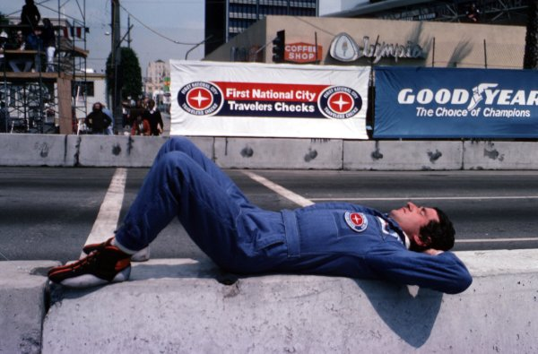 1977 Formula 1 World Championship.Patrick Depailler (Tyrrell-Ford Cosworth) asleep on the pit wall.Ref-D2A 05.World - LAT Photographic