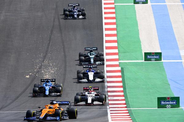 Daniel Ricciardo, McLaren MCL35M, leads Antonio Giovinazzi, Alfa Romeo Racing C41, and Fernando Alonso, Alpine A521, as sparks fly