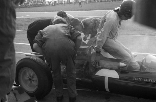Jim Clark climbs out of his Lotus 25 Climax.