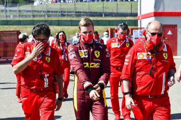 Mick Schumacher talks with Ferrari personnel