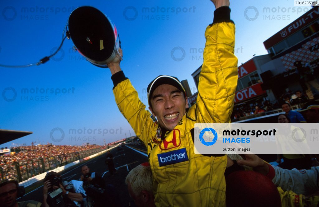 Takuma Sato (JPN) Jordan celebrates his first F1 points with a superb fifth place finish in his home GP. Formula One World Championship, Rd17, Japanese Grand Prix, Suzuka, Japan, 13 October 2002. BEST IMAGE