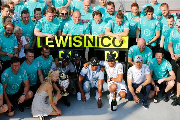Hungaroring, Budapest, Hungary. Sunday 24 July 2016. Lewis Hamilton, Mercedes AMG, 1st Position, his friends, Nico Rosberg, Mercedes AMG, 2nd Position, and the Mercedes team celebrate. World Copyright: Andy Hone/LAT Photographic ref: Digital Image _ONZ4271