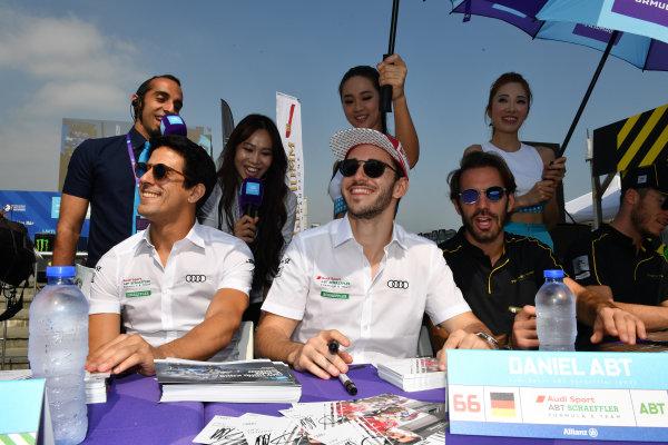 2017/2018 FIA Formula E Championship. Round 2 - Hong Kong, China. Sunday 03 November 2017. Lucas Di Grassi (BRA), Audi Sport ABT Schaeffler, Audi e-tron FE04, and Daniel Abt (GER), Audi Sport ABT Schaeffler, Audi e-tron FE04, sign autographs for fans. Photo: Mark Sutton/LAT/Formula E ref: Digital Image DSC_4853