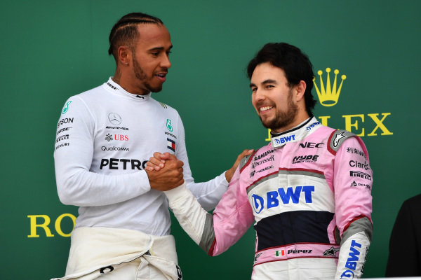 Race winner Lewis Hamilton (GBR) Mercedes-AMG F1 and Sergio Perez (MEX) Force India celebrate on the podium