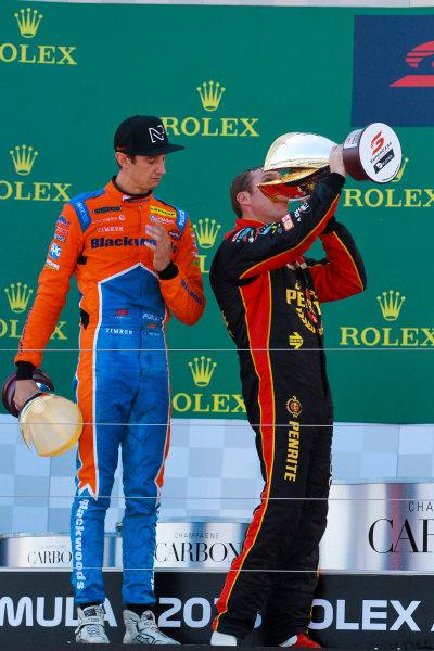 David Reynolds, Erebus Motorsport Holden, 1st position, drinks from his trophy alongside Nick Percat, Brad Jones Racing Holden, 2nd position, on the podium.
