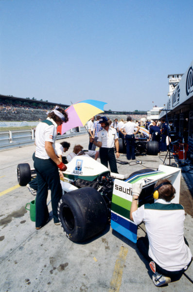 Hockenheim, Germany. 28th - 30th July 1978Alan Jones (Williams FW06-Ford), retired, in the pits as Ross Brawn with headband, looks on, action.World Copyright: LAT PhotographicRef: 35mm Colour Transparency.