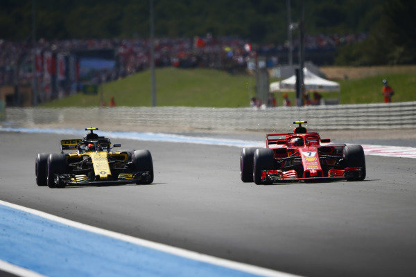 Kimi Raikkonen, Ferrari SF71H, passes Carlos Sainz Jr., Renault Sport F1 Team R.S. 18.