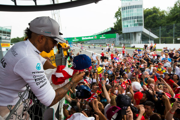 Autodromo Nazionale di Monza, Italy. Sunday 4 September 2016. Lewis Hamilton, Mercedes AMG, 2nd Position, signs autographs for fans. World Copyright: Sam Bloxham/LAT Photographic ref: Digital Image _SBB9738
