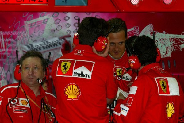 (L to R): Jean Todt (FRA) Ferrari General Manager and Michael Schumacher (GER) Ferrari discuss qualifying in the garage.