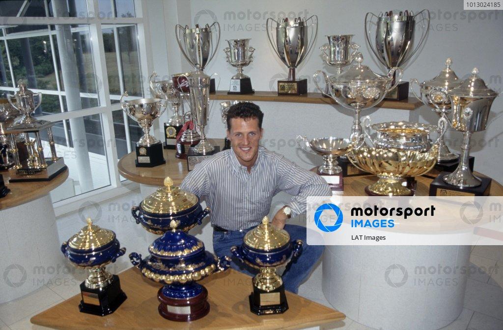 1995 F1 World Championship. Michael Schumacher, Benetton, World Champion with trophies. World Copyright: LAT Photographic