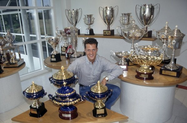 1995 F1 World Championship. Michael Schumacher, Benetton, World Champion with trophies. World Copyright: LAT Photographic