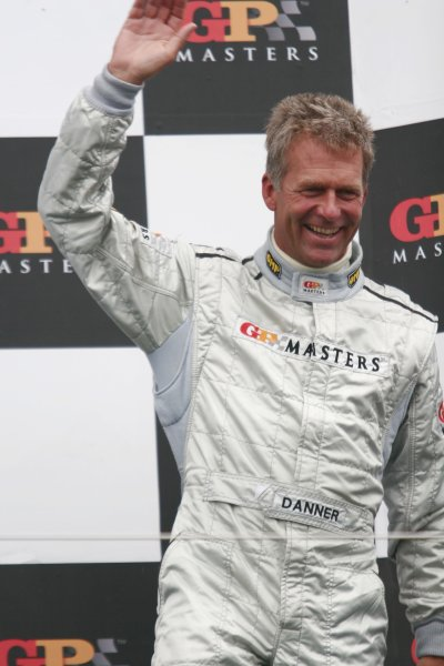 2006 Grand Prix Masters.Silverstone, England. 11th - 13th August.Christian Danner celebrates on the podium. Portrait.World Copyright: Drew Gibson/LAT Photographic.Ref: Digital Image Only.