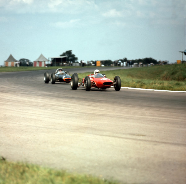 Silverstone, England.18-20 July 1963.John Surtees (Ferrari 156) leads Graham Hill (BRM P57). They finished in 2nd and 3rd positions respectively.Ref-3/0998.World Copyright - LAT Photographic