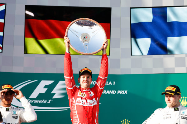 Albert Park, Melbourne, Australia. Sunday 26 March 2017. Sebastian Vettel, Ferrari, 1st Position, celebrates victory on the podium with his trophy. World Copyright: Glenn Dunbar/LAT Images ref: Digital Image _X4I3922