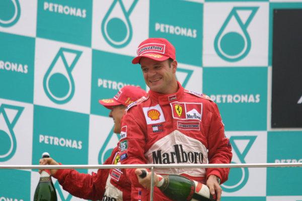 2001 Malaysian Grand Prix.Sepang, Kuala Lumpur, Malaysia. 16-18 March 2001.Rubens Barrichello (Ferrari) 2nd position celebrates on the podium.World Copyright - LAT Photographicref: 8 9MB DIGITAL IMAGE