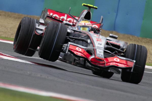 Lewis Hamilton, McLaren MP4-22 Mercedes get airborne over the kerbs.