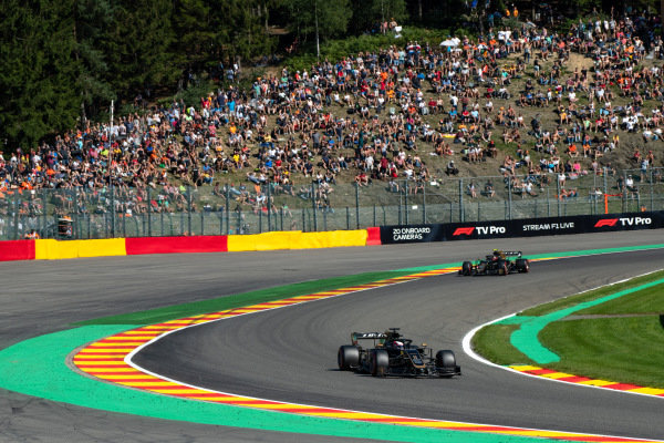 rRomain Grosjean, Haas VF-19, leads Kevin Magnussen, Haas VF-19