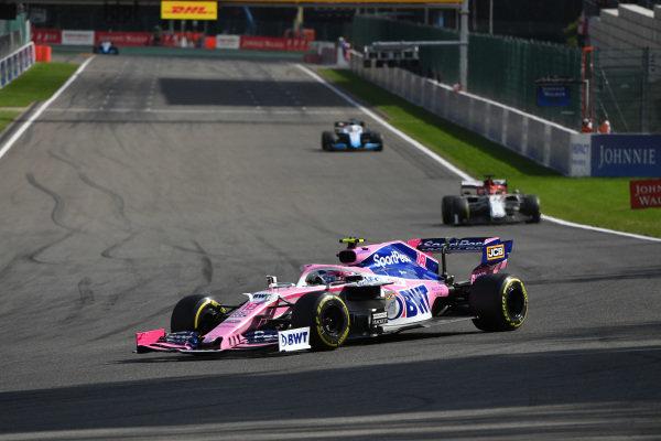 Lance Stroll, Racing Point RP19, leads Kimi Raikkonen, Alfa Romeo Racing C38, and George Russell, Williams Racing FW42