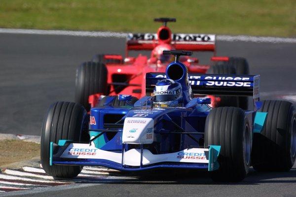 2001 European Grand Prix. RACENurburgring, Germany. 24th June 2001Michael Schumacher, Ferrari F2001, about to lap Kimi Raikkonen, Sauber Petronas C20, action.World Copyright - LAT Photographicref: 8 9 MB Digital File Only
