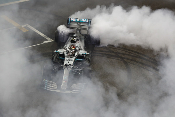 Lewis Hamilton, Mercedes AMG F1 W10, 1st position, performs a donut on the grid in celebration, at the end of the race