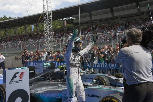 Nico Rosberg celebrates victory in parc ferme.