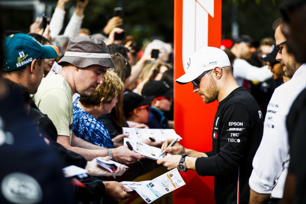 Valtteri Bottas, Mercedes AMG F1 signs a autograph for a fan at the Federation Square event