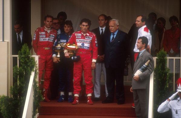 1990 Monaco Grand Prix.Monte Carlo, Monaco. 25-27 May 1990.Ayrton Senna (McLaren Honda) 1st position, Jean Alesi (Tyrrell Ford) 2nd position and Gerhard Berger (McLaren Honda) 3rd position on the podium. Also standing with them is HSH Prince Rainier of Monaco, HSH Prince Albert and McLaren team boss Ron Dennis. Ref-90 MON 08.World Copyright - LAT Photographic