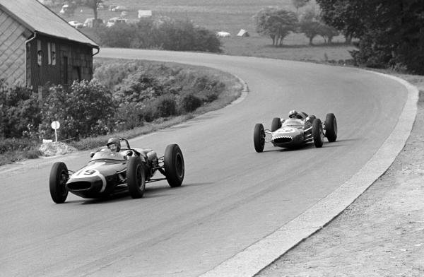 Ninth place finisher Lucien Bianchi (BEL) Lotus 18/21 leads Jo Siffert (SUI) Lotus 21 who finished tenth on his Grand Prix race debut.