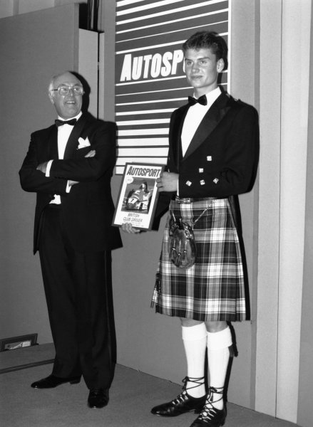 Cafe Royal, London, Great Britain. 4 January 1990.David Coulthard becomes the 1989 McLaren Autosport Young Driver of the Year with Murray Walker looking on, portrait.World Copyright: LAT PhotographicRef: B/W Print.