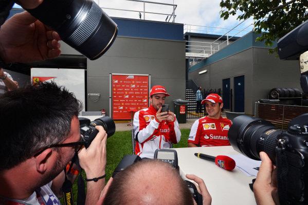 Fernando Alonso (ESP) Ferrari and Felipe Massa (BRA) Ferrari talk with the media. Formula One World Championship, Rd1, Australian Grand Prix, Practice, Albert Park, Melbourne, Australia, Friday 15 March 2013.
