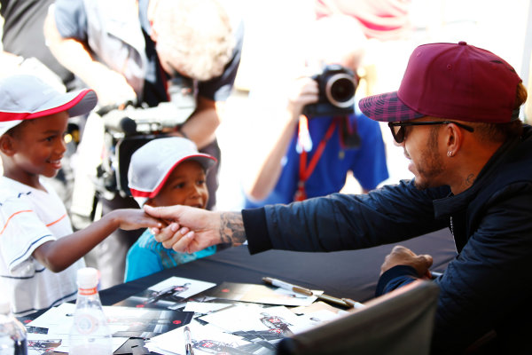 Circuit Gilles Villeneuve, Montreal, Canada. Thursday 08 June 2017. Lewis Hamilton, Mercedes AMG, greets a pair of young fans. World Copyright: Andy Hone/LAT Images ref: Digital Image _ONY2368