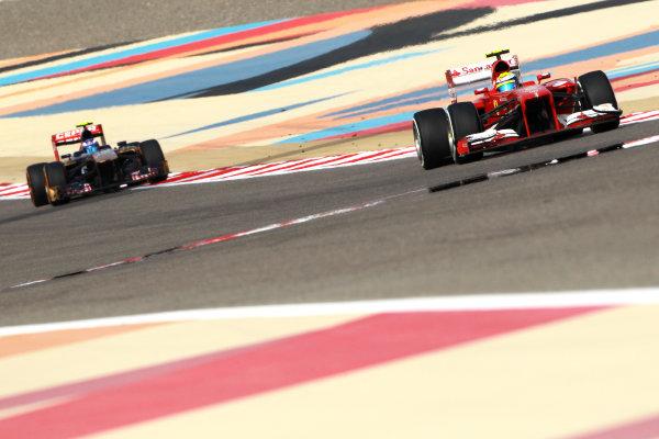Bahrain International Circuit, Sakhir, Bahrain Sunday 21st April 2013 Felipe Massa, Ferrari F138, leads Daniel Ricciardo, Toro Rosso STR8 Ferrari.  World Copyright: Andy Hone/LAT Photographic ref: Digital Image HONY1204