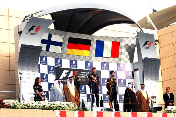 Bahrain International Circuit, Sakhir, Bahrain Sunday 21st April 2013 Sebastian Vettel, Red Bull Racing, 1st position, Kimi Raikkonen, Lotus F1, 2nd position, and Romain Grosjean, Lotus F1, 3rd position, on the podium. World Copyright: Andy Hone/LAT Photographic ref: Digital Image HONY1885