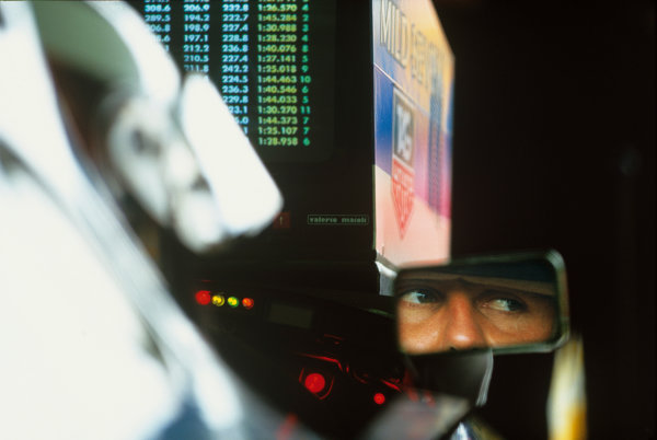 Adelaide, Australia.5-7 November 1993.Michael Schumacher (Benetton Ford) keeps an eye on his fellow competitors during qualifying on the timing monitor.World Copyright - LAT Photographic
