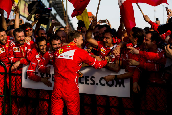 Albert Park, Melbourne, Australia. Sunday 26 March 2017. Sebastian Vettel, Ferrari, 1st Position, celebrates in Parc Ferme with his team. World Copyright: Zak Mauger/LAT Images ref: Digital Image _56I1967