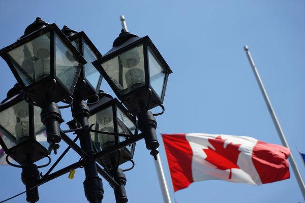 Circuit Gilles Villeneuve, Montreal, Canada. Wednesday 3 June 2015. Street lamps and a Canadian flag. World Copyright: Glenn Dunbar/LAT Photographic. ref: Digital Image DSC00476