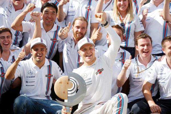 Red Bull Ring, Spielberg, Austria. Sunday 22 June 2014. Felipe Massa, Williams F1, and Valtteri Bottas, Williams F1, celebrate with their team. World Copyright: Charles Coates/LAT Photographic. ref: Digital Image _N7T5120