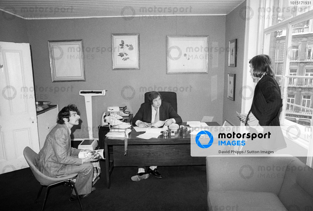 Lord Alexander Hesketh (GBR) Hesketh Team Owner (Centre) behind the desk at the headquarters of Hesketh Racing. Formula One World Championship, London, England, c. Late April 1974.