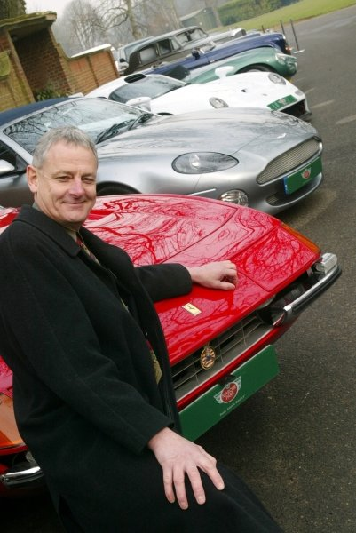 David Grace (GBR) and a Ferrari Daytona, Aston Martin Vanquish and Porsche 911 GT1 road car.