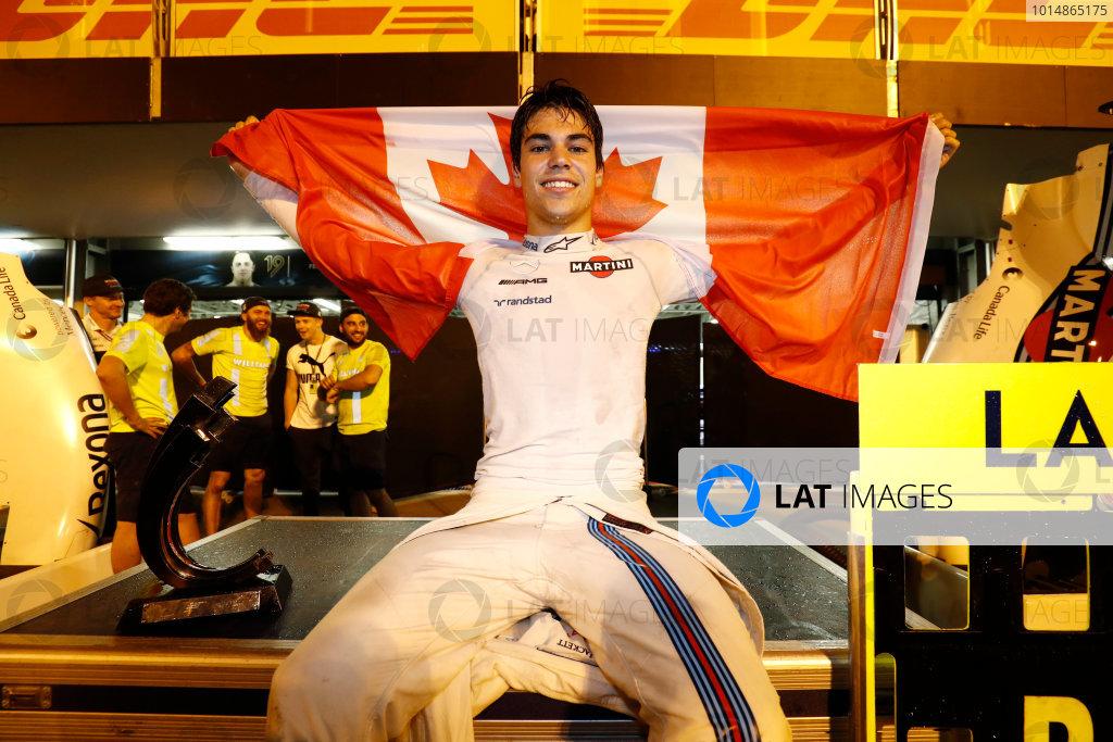 Baku City Circuit, Baku, Azerbaijan. Sunday 25 June 2017. Lance Stroll, Williams FW40 Mercedes, celebrates third place by displaying a Canadian flag in the pit lane. World Copyright: Glenn Dunbar/LAT Images ref: Digital Image _31I4144