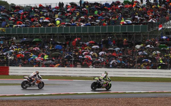 British Grand Prix.  Silverstone, England. 10th-12th June 2011.  Loris Capirossi, Ducati, leads Hiroshi Aoyama, Honda. Action.  World Copyright: Kevin Wood/LAT Photographic.  ref: Digital Image