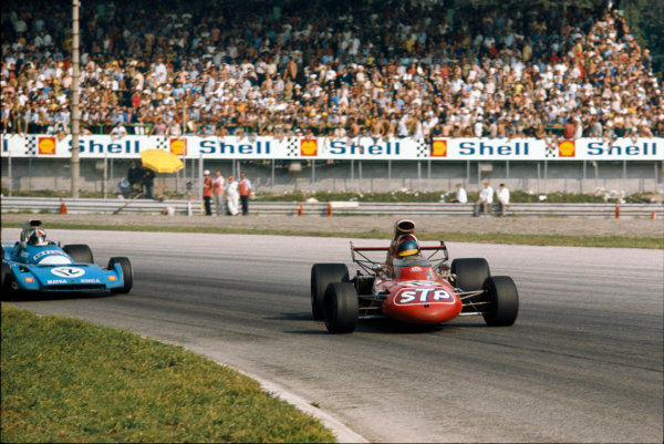 Monza, Italy. 3 - 5 September 1971.Ronnie Peterson (March 711-Ford), 2nd position, gets sideways in Parabolica ahead of Chris Amon (Matra-Simca MS120B), 6th position. 