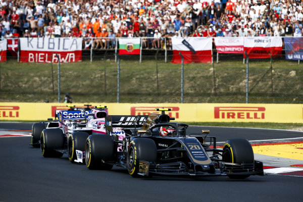 Kevin Magnussen, Haas VF-19, leads Lance Stroll, Racing Point RP19, and Antonio Giovinazzi, Alfa Romeo Racing C38, on the formation lap