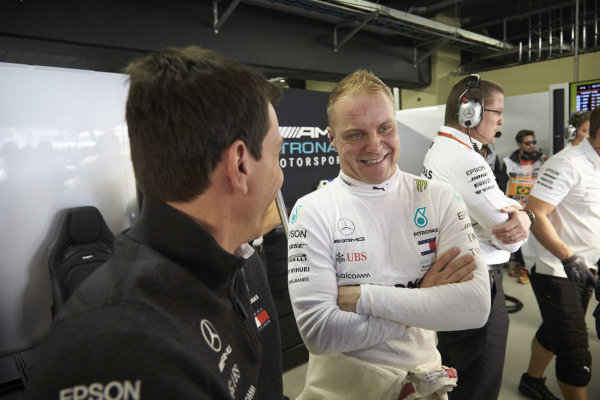 Toto Wolff, Executive Director (Business), Mercedes AMG, talks with Valtteri Bottas, Mercedes AMG F1