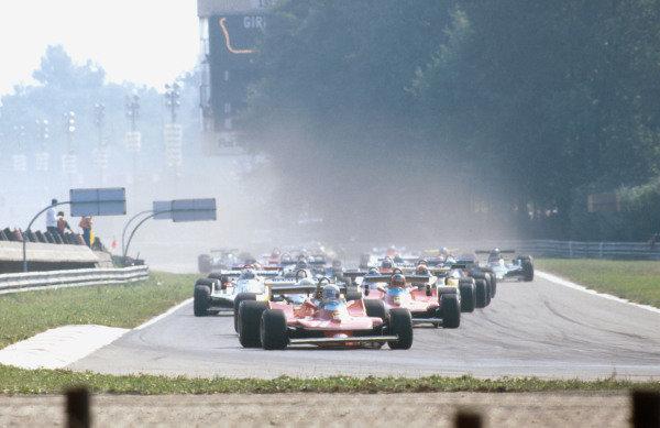 1979 Italian Grand Prix.Monza, Italy.7-9 September 1979.Jody Scheckter (Ferrari 312T4) leads the rest of the field into Rettifilo at the start.Ref-79 ITA 03.World Copyright - LAT Photographic