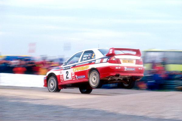 1998 World Rally ChampionshipNetwork Q, United Kingdom. 21st - 24th November 1998.Richard Burns' first WRC win on home soil. Mitsubishi Lancer, actionWorld Copyright: Graeme Brown/LAT Photographic